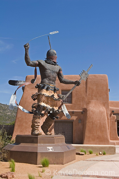 Apache Mountain Spirit Dancer by Craig Dan Goseyun in front of the Laboratory of Anthropology and Museum of Indian Arts and Culture on Museum Hill, Santa Fe, New Mexico