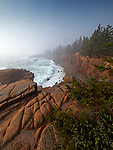Waves crash into the granite coastline along Ocean Drive near Thunder Hole in Acadia National Park, Maine, USA