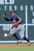Shortstop Johan Camargo (24) of the Rome Braves tracks a ground ball in a game against the Greenville Drive on Friday, August 1, 2014, at Fluor Field at the West End in Greenville, South Carolina. Rome won, 5-1. (Tom Priddy/Four Seam Images)