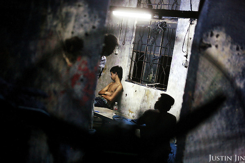 "A worker takes a dawn break after scrubbing jeans all night using a sanding machine in Mr Huang's factory in Zhongshan city, China..This picture is part of a photo and text story on blue jeans production in China by Justin Jin. .China, the ""factory of the world"", is now also the major producer for blue jeans. To meet production demand, thousands of workers sweat through the night scrubbing, spraying and tearing trousers to create their rugged look. .At dawn, workers bundle the garment off to another factory for packaging and shipping around the world..The workers are among the 200 million migrant labourers criss-crossing China.looking for a better life, at the same time building their country into a.mighty industrial power."