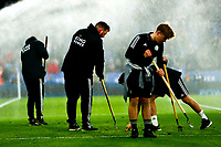 11th January 2020; King Power Stadium, Leicester, Midlands, England; English Premier League Football, Leicester City versus Southampton; Groundsmen tend to the King Power Stadium pitch in front of the sprinklers before kick-off - Strictly Editorial Use Only. No use with unauthorized audio, video, data, fixture lists, club/league logos or 'live' services. Online in-match use limited to 120 images, no video emulation. No use in betting, games or single club/league/player publications