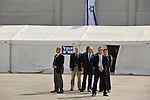 Israeli Prime Minister Ehud Olmert (3R) waits for German Chancellor Angela Merkel, before a welcoming ceremony at Ben Gurion airport in Israel, Sunday, March 16, 2008.<br /> (Photo by Ahikam Seri).