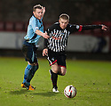 Pars' Andrew Geggan is pulled back by Forfar's Mark Baxter.