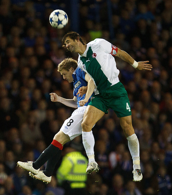 Steven Davis comes off second best to giant defender Omer Erdrogan