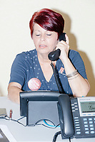 Inez Yimoc, 55, of Hialeah, calls potential voters at the Donald Trump campaign office in Hialeah, Miami, Florida, on Sun., Oct. 9, 2016.