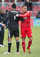 06 April 2013: Toronto FC midfielder Luis Silva #11 shakes hands with FC Dallas goalkeeper Raul Fernandez #1 at the end of an MLS game between FC Dallas and Toronto FC at BMO Field in Toronto, Ontario Canada..The game ended in a 2-2 draw..