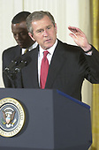 United States President George W. Bush makes remarks to African-American leaders in the East Room of the White House in Washington, DC on March 29, 2001.  US  Representative J.C. Watts (Republican of Oklahoma) looks on at left.<br /> Credit: Ron Sachs / CNP