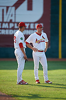 Johnson City Cardinals pitcher Parker Kelly (13) talks with pitcher Michael Brettell (26) during a game against the Danville Braves on July 29, 2018 at TVA Credit Union Ballpark in Johnson City, Tennessee.  Johnson City defeated Danville 8-1.  (Mike Janes/Four Seam Images)