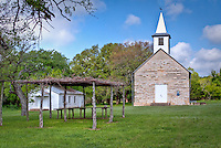 St. John's Lutheran Chuch near Fredericksburg Texas.<br /> Pioneer families of Crabapple organized St. John's Lutheran Church in the 1880s, and members met in the nearby school building before erecting the sanctuary in 1897. Elder Julius Rusche supervised the design, carpentry, and native limestone masonry construction of the church, which is an excellent example of vernacular architecture with slight Gothic influences. The building features a massive stone foundation and double door entry. The 4/4 wood windows have stone lintels and sills. <br /> <br /> Regular services were discontinued in 1962 but an annual homecoming service is held the fourth Sunday of September. <br /> <br /> The church was designated as Texas Historic Landmark in 1994