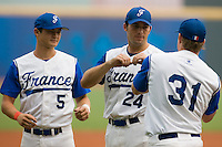 19 August 2007: #5 Kenji Hagiwara, #24 Gaspard Fessy and #31 Anthony Cros during players introduction prior to the Japan 4-3 victory over France in the Good Luck Beijing International baseball tournament (olympic test event) at the Wukesong Baseball Field in Beijing, China.
