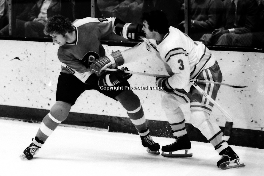 Seals vs Philadelphia Flyers 1975. Seals Mike Christie and Flyers Don Saleski (photo/Ron Riesterer)