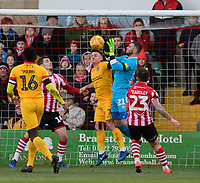 Lincoln City's Grant Smith under pressure from Northampton Town's Sam Hoskins<br /> <br /> Photographer Chris Vaughan/CameraSport<br /> <br /> The EFL Sky Bet League Two - Lincoln City v Northampton Town - Saturday 9th February 2019 - Sincil Bank - Lincoln<br /> <br /> World Copyright &copy; 2019 CameraSport. All rights reserved. 43 Linden Ave. Countesthorpe. Leicester. England. LE8 5PG - Tel: +44 (0) 116 277 4147 - admin@camerasport.com - www.camerasport.com