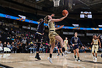 Alex Sharp (14) of the Wake Forest Demon Deacons drives the baseline past Jessica Shepard (23) of the Notre Dame Fighting Irish for a reverse lay-up during second half action at the LJVM Coliseum on December 31, 2017 in Winston-Salem, North Carolina.  The Fighting Irish defeated the Demon Deacons 96-73.  (Brian Westerholt/Sports On Film)