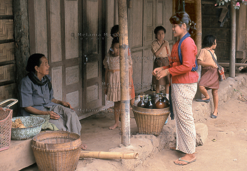 Indonesia, Java island, woman selling  jamu (traditional Javanese herbal medicine).<br />