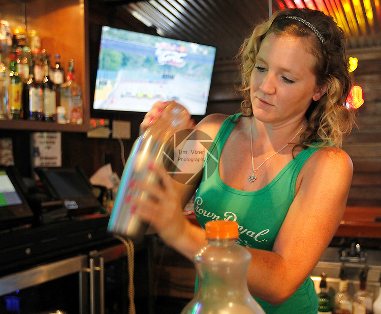 """Bartender Zoey Hill from New Athens makes a specialty drink she created called """"Muddy Water"""".  It contains vodka and schnaps, plus other secret ingredients known only to Hill."""