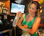 "Bartender Zoey Hill from New Athens makes a specialty drink she created called ""Muddy Water"".  It contains vodka and schnaps, plus other secret ingredients known only to Hill."