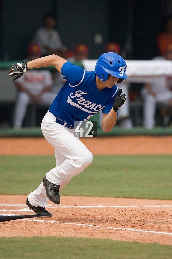 18 August 2007: Center Field #5 Kenji Hagiwara connects for a bunt during the China 5-1 victory over France in the Good Luck Beijing International baseball tournament (olympic test event) at the Wukesong Baseball Field in Beijing, China.