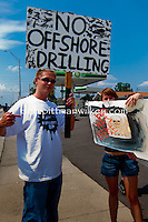Holding signs and waving at honking supporters a small group gathered at the BP service station in St. Petersburg, Florida to show suppot for Worldwide BP Boycott on Saturday, June 12, 2010. Volunteers from the Suncoast Seabird Sanctuary were on-hand to raise donations, Emergency Call List volunteers, and items & materials needed to prepare for injured birds and coastal cleanup,  Photo by Debi PIttman Wilkey