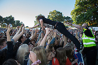 Matt Bowman of The Pigeon Detectives dives into fans at AmpRocks  2016 at Ampthill Great Park, Ampthill, England on 1 July 2016. Photo by David Horn.