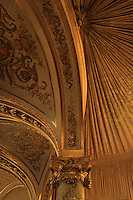 "Detaiil of vaulted ceiling, capital and column, with drapery, in the balcony, Theatre Imperial Napoleon III de Fontainebleau (Fontainebleau Theatre Napoleon III), 1853-1856, by Hector Lefuel, lit by the original lightings of the 19th century, Fontainebleau, Seine-et-Marne, France. Restoration of the theatre began in Spring 2013 thanks to an agreement between the Emirate of Abu Dhabi and the French Governement dedicating 5 M€ to the restoration.  In recognition of the sponsorship by the Emirate of Abu Dhabi, French Governement decided to rename the theatre as ""Theatre Cheikh Khalifa bin Zayed Al Nahyan"" (Cheikh Khalifa bin Zayed Al Nahyan Theatre). The achievement of a first stage of renovation will allow the opening of the theatre to the public on May 3, 2014. Picture by Manuel Cohen"