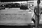 Boy looking over tomb of Martin Luther King Jr on the day of his burial. Photo by Jim Peppler published in The Southern Courier April 20, 1968. Copyright Jim Peppler/1968.    This and over 10,000 other images are part of the Jim Peppler Collection at The Alabama Department of Archives and History. http://digital.archives.alabama.gov/cdm4/peppler.php