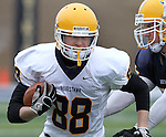 SIOUX FALLS, SD - MAY 4:  Brady Boike #88 from Augustana's offense tries to get past Nevin Andreas #37 from the defense during the Vikings Spring Game Saturday morning at Kirkeby-Over Stadium on the Augustana College Campus. (Photo by Dave Eggen/Inertia)