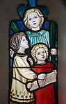Stained glass window children singing, church porch Saint Peter, Blaxhall, Suffolk, England, UK designed by Ellen Rope 1914