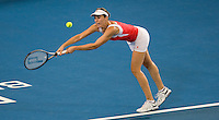 Maria Jose Martinez Sanchez (ESP) against Smanatha Stosur (AUS) in the Group A match between Spain and Australia.  Martinez Sanchez beat Stosur 6-4 6-1..International Tennis - Hyundai Hopman Cup XXII - Thur 07 Jan 2010 - Burswood Dome - Perth - Australia ..© Frey - AMN Images, 1st Floor Barry House, 20-22 Worple Road, London, SW19 4DH
