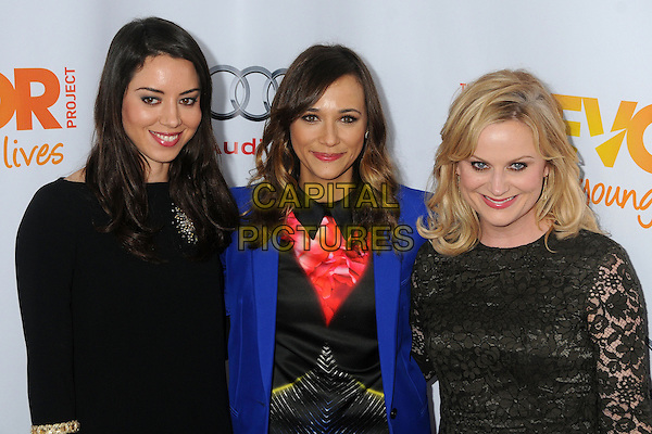 "Aubrey Plaza, Rashida Jones, Amy Poehler.The Trevor Project's ""Trevor Live"" 2012 held at the Hollywood Palladium, Hollywood, California, USA..December 2nd, 2012.half length dress lace black blue blazer pink top pattern .CAP/ADM/BP.©Byron Purvis/AdMedia/Capital Pictures."