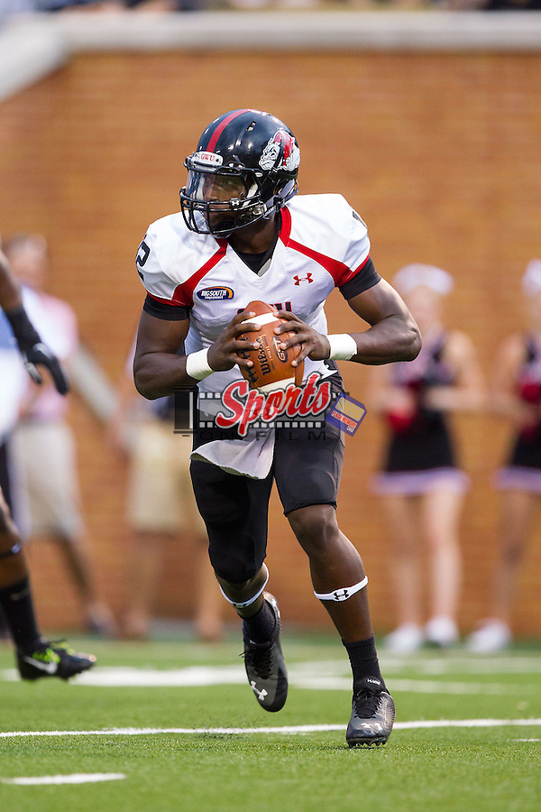 Gardner-Webb Runnin' Bulldogs quarterback Tyrell Maxwell (12) rolls out to his left during first half action against the Wake Forest Demon Deacons at BB&T Field on September 6, 2014 in Winston-Salem, North Carolina.  The Demon Deacons defeated the Runnin' Bulldogs 23-7.   (Brian Westerholt/Sports On Film)