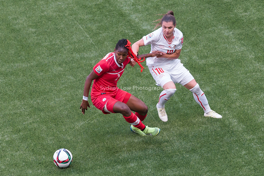 June 21, 2015: Kadeisha BUCHANAN of Canada and Ramona BACHMANN of Switzerland fight for the ball during a round of 16 match between Canada and Switzerland at the FIFA Women's World Cup Canada 2015 at BC Place Stadium on 21 June 2015 in Vancouver, Canada. Canada won 1-0. Sydney Low/Asteriskimages.com