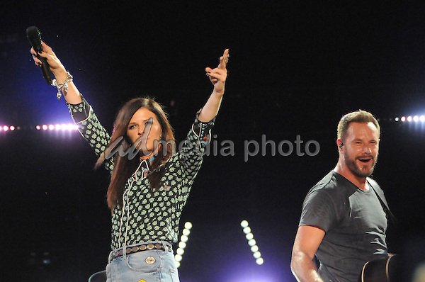 12 June 2016 - Nashville, Tennessee - Karen Fairchild, Jimi Westbrook, Little Big Town. 2016 CMA Music Festival Nightly Concert held at Nissan Stadium. Photo Credit: Dara-Michelle Farr/AdMedia