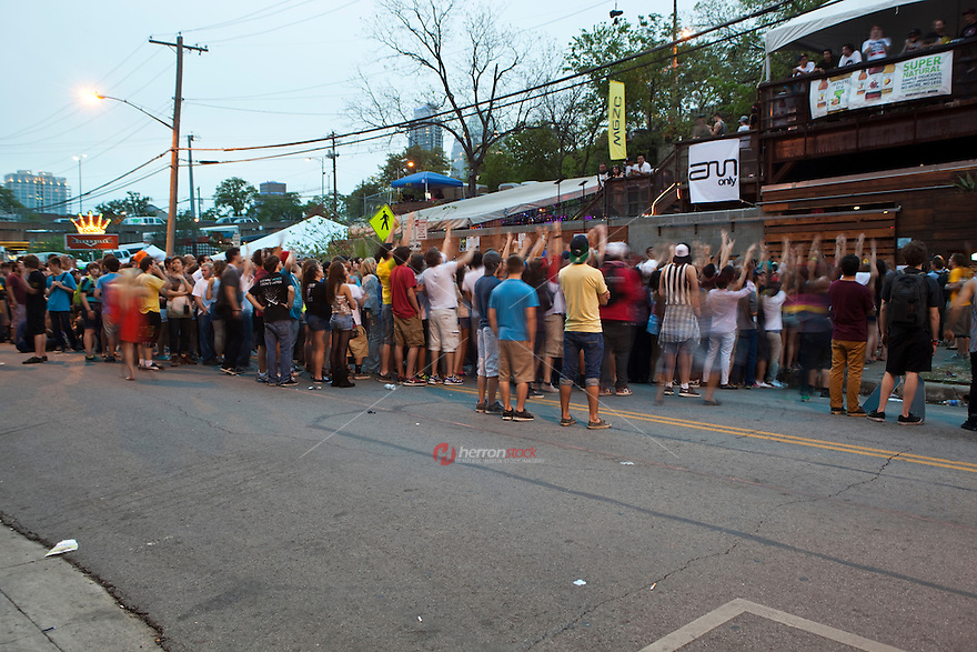 Insanely-hyped artists at SXSW draw long lines at Red River music venues, an eclectic three blocks of the best, and most, live music in Austin