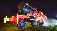 BNPS.co.uk (01202 558833)<br /> Pic: PhilYeomans/BNPS<br /> <br /> Poppy and Lily Wellstead next to the illuminated full size steam train at the Festival. <br /> <br /> As the clocks go back the lights come on at Longleat House in Wiltshire - as the hugely popular Festival of Light switches on.<br /> <br /> The English country estate is transformed with 800 illuminated lanterns to take visitors on a magical journey around the world and under the sea.<br /> <br /> Staff at the popular park attraction say this is their most ambitious event yet, with a team of highly-skilled Chinese artists spending more than 7,000 hours to complete the different stories for A Fantastic Voyage.<br /> <br /> The displays have used more than 25 miles of silk and LED lighting strips, as well as more than 60,000 light bulbs.