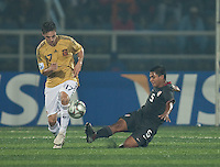 Bryan Duran (5) slide tackles Pablo Sarabia (17). Spain defeated the U.S. Under-17 Men National Team  2-1 at Sani Abacha Stadium in Kano, Nigeria on October 26, 2009.