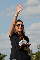 Sara Whalen waves to the fans after being presented an award honoring her for being part of the 1999 Women's World Cup winning team. Sky Blue FC defeated the Boston Breakers 1-0 during a Women's Professional Soccer match at Yurcak Field in Piscataway, NJ, on July 4, 2009.