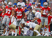 Ohio State Buckeyes linebacker Chris Worley (35) and Ohio State Buckeyes defensive end Nick Bosa (97) celebrate after Tulsa Golden Hurricane running back James Flanders (20) was stopped on 4th down in the first period  during an NCAA football game between the Ohio State Buckeyes and the Tulsa Golden Hurricane at Ohio Stadium on Saturday, September 10, 2016. (Columbus Dispatch photo by Fred Squillante)