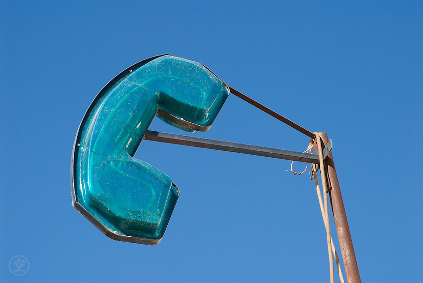A blue sign indicating telephones against the blue sky in Sefrou, Morocco.