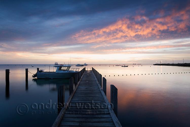 Dawn over a jetty on Thomson Bay.  Rottnest Island, Western Australia, AUSTRALIA.