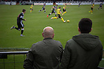 Two spectators in front of the main stand watching the action at Borough Briggs, home to Elgin City, on the day they played SPFL2 newcomers Edinburgh City (in yellow). Elgin City were a former Highland League club who were elected to the Scottish League in 2000, whereas Edinburgh City became the first club to gain promotion to the League by winning the Lowland League title and subsequent play-off matches in 2015-16. This match, Edinburgh City's first away Scottish League match since 1949, ended in a 3-0 defeat, watched by a crowd of 610.