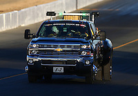 Jul. 25, 2014; Sonoma, CA, USA; NHRA Safety Safari truck checks out the track surface during qualifying for the Sonoma Nationals at Sonoma Raceway. Mandatory Credit: Mark J. Rebilas-