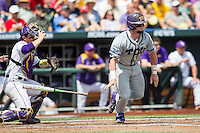 TCU Horned Frogs catcher Evan Skoug (9) hustles down the first base line against the LSU Tigers in the NCAA College World Series on June 14, 2015 at TD Ameritrade Park in Omaha, Nebraska. TCU defeated LSU 10-3. (Andrew Woolley/Four Seam Images)