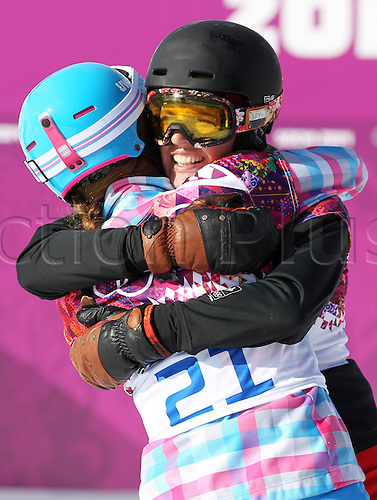 19.02.2014. Sochi, Russia.  Rosa Khutor   Sochi Winter Olympic Wiomens Giant Parallel Slalom Snowboarding.  Alena Zavarzina (RUS, L) hugs fellow competitor Patrizia Kummer (SUI, R)