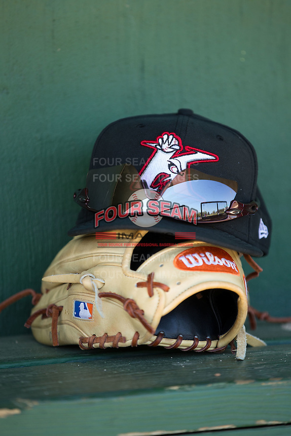 A Kannapolis Intimidators cap sits on top of a Wilson baseball glove during a preseason workout at Kannapolis Intimidators Stadium on April 5, 2016 in Kannapolis, North Carolina.  (Brian Westerholt/Four Seam Images)