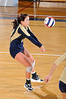 17 November 2011:  FIU defensive specialist/libero Chanel Araujo (13) returns a serve in the third set as the FIU Golden Panthers defeated the Denver University Pioneers, 3-1 (25-21, 23-25, 25-21, 25-18), in the first round of the Sun Belt Conference Tournament at U.S Century Bank Arena in Miami, Florida.
