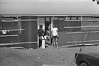 Co Founder of Rip Curl Doug 'Claw' Warbrick (AUS) with Pipeline ledgend Rory Russell (HAW)  standing at the judging sheds during the  running of the 1976 Rip Curl Pro, Bells Beach, Torquay, Victoria, Australia. Easter 1976.Photo:  joiliphotos.com