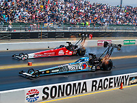 Jul 28, 2019; Sonoma, CA, USA; NHRA top fuel driver Antron Brown (near) races alongside Doug Kalitta during the Sonoma Nationals at Sonoma Raceway. Mandatory Credit: Mark J. Rebilas-USA TODAY Sports