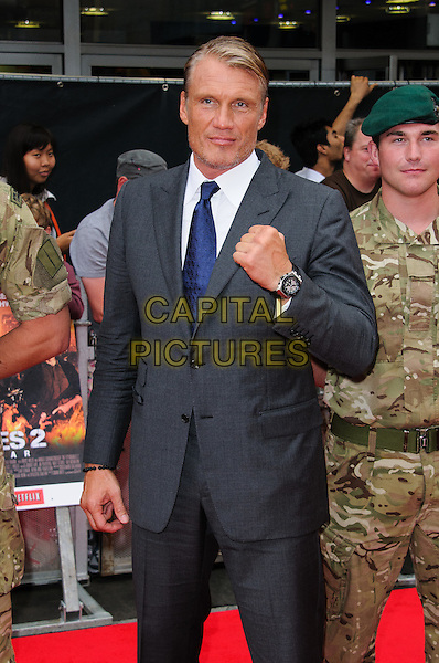 Dolph Lundgren.'The Expendables 2' UK film premiere held at the Empire Leicester Square,.London, England..13th August 2012.half length hand fist blue tie white shirt grey gray suit stubble facial hair .CAP/CJ.©Chris Joseph/Capital Pictures.