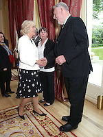 17 May 2016 - London, England - Camilla Duchess of Cornwall (left, who is a patron of the charity) is greeted by Terry Waite, who is president of the charity, at a reception to celebrate the 25th anniversary of Emmaus UK  - which supports former homeless people by giving them a home within one of its Emmaus Communities - at the French Ambassador's Residence in Kensington, London. Photo Credit: ALPR/AdMedia