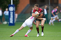 20120823 Copyright onEdition 2012©.Free for editorial use image, please credit: onEdition..Owen Farrell of Saracens is tackled by Hugo Bonneval of Stade Francais Paris at The Honourable Artillery Company, London in the pre-season friendly between Saracens and Stade Francais Paris...For press contacts contact: Sam Feasey at brandRapport on M: +44 (0)7717 757114 E: SFeasey@brand-rapport.com..If you require a higher resolution image or you have any other onEdition photographic enquiries, please contact onEdition on 0845 900 2 900 or email info@onEdition.com.This image is copyright the onEdition 2012©..This image has been supplied by onEdition and must be credited onEdition. The author is asserting his full Moral rights in relation to the publication of this image. Rights for onward transmission of any image or file is not granted or implied. Changing or deleting Copyright information is illegal as specified in the Copyright, Design and Patents Act 1988. If you are in any way unsure of your right to publish this image please contact onEdition on 0845 900 2 900 or email info@onEdition.com
